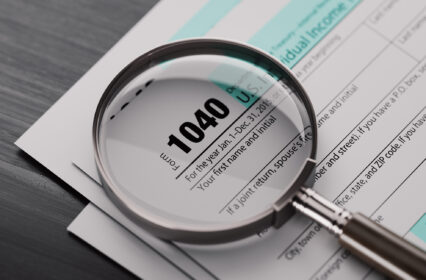 1040 Tax Form And A Magnifying Glass